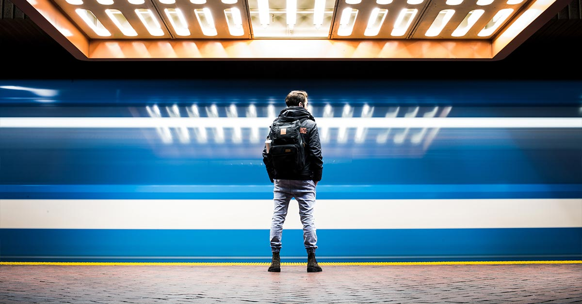person standing on a train platform