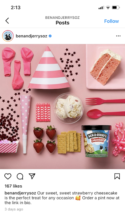Ben and Jerry's creatively and attractively position the ingredients for a strawberry cheesecake along with party supplies to promote their strawberry cheesecake ice cream.